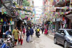 Translation: The crowd around Thamel during daytime, the backpacker haven in Kathmandu royalty free stock images