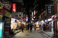 Translation: The crowd around Thamel at night, the backpacker ha stock images