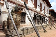 Translation: The lion like statues around Bhaktapur Durbar Square. Taken in Nepal, August 2018 stock image