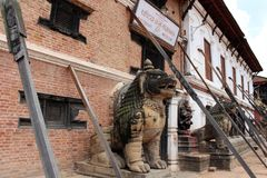 Translation: The lion like statues around Bhaktapur Durbar Square. Taken in Nepal, August 2018 stock photography