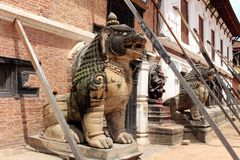Translation: The lion like statues around Bhaktapur Durbar Square. Taken in Nepal, August 2018 royalty free stock photos
