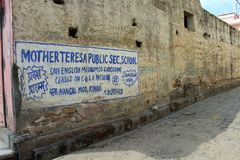 Translation: the mural of Mother Teresa school around Amer Amber Fort in Jaipur stock photography