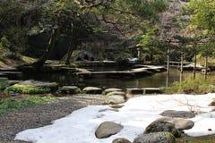 Translation: `Oyama Shrine`. It was covered by light snow. Taken in Kanazawa, Japan - February 2018 royalty free stock photo
