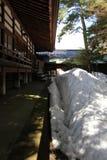 Translation: `Oyama Shrine`. It was covered by light snow. Taken in Kanazawa, Japan - February 2018 royalty free stock photography
