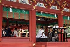 Translation: Shinto priests leading a wedding ceremony, at Tusurgaoka Shrine. Taken in Kamakura, Japan, March 2018 royalty free stock photos