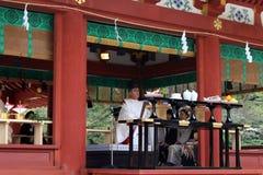 Translation: Shinto priests leading a wedding ceremony, at Tusurgaoka Shrine. Taken in Kamakura, Japan, March 2018 stock photography