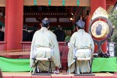Translation: Shinto priests leading a wedding ceremony, at Tusurgaoka Shrine. Taken in Kamakura, Japan, March 2018 royalty free stock photo