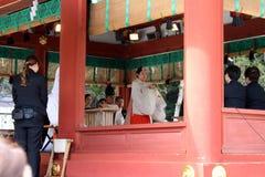 Translation: Shinto priests leading a wedding ceremony, at Tusurgaoka Shrine. Taken in Kamakura, Japan, March 2018 royalty free stock images