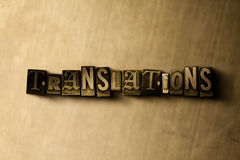 TRANSLATIONS - close-up of grungy vintage typeset word on metal backdrop Stock Image