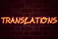 Translations neon sign on brick wall background. Fluorescent Neon tube Sign on brickwork Business concept for  Translate Explain P. Lead Book Language 3D Royalty Free Stock Photo