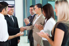 Translator arab businessman. Young translator introducing arab businessman to group of businesspeople Stock Photos