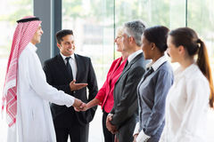 Translator introducing Arabian businessman. Young translator introducing Arabian businessman to business partners Stock Images