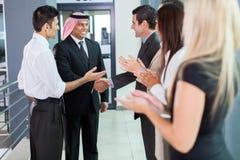 Translator introducing businessman. Translator introducing Arabian businessman to business partners Stock Photography