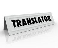 Translator Tent Card Word Foreign International. Translator word on a tent or name card to illustrate someone who can translate one language into another for stock illustration