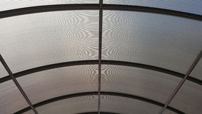 Translucent architectural canopy roof with steel frame structure. Close up detail of translucent architectural canopy roof with steel frame structure in daytime Royalty Free Stock Photos