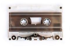 Translucent audio cassette tape isolated on white. Background Royalty Free Stock Photo