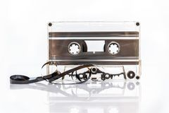 Translucent audio cassette tape isolated on white. Background Royalty Free Stock Photography