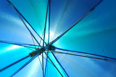 Translucent blue umbrella Royalty Free Stock Photo