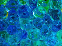 Translucent blue and yellow glass beads Stock Images