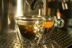 Translucent glass cups of espresso prepared in espresso mach Royalty Free Stock Image
