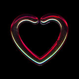 Translucent heart. A translucent heart reflecting red and green lights on black background royalty free stock image