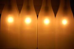 Translucent milk bottles stock image