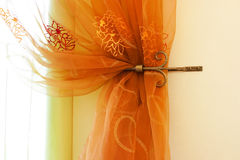 Translucent orange curtains Stock Photos