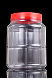 Translucent plastic PVC jar with red cover isolated in black Stock Photos