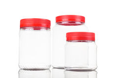 Translucent plastic PVC jar with red cover isolated in white Royalty Free Stock Photos