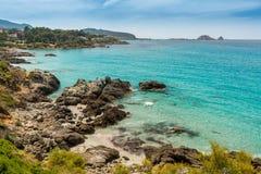 Translucent sea and rocky coastline of Corsica near Ile Rousse Stock Photo