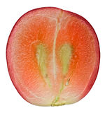 Translucent slice of red grape fruit Royalty Free Stock Photos