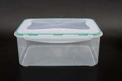 Translucent storage box on black Royalty Free Stock Photography