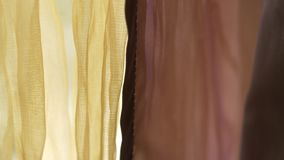 Translucent yellow and burgundy chiffon curtain. Bedroom, cafe or club close-up stock footage