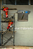 Transmilenio Workers. Workers working to get the new Transmilenio line up and running in Bogotá, Colombia Stock Photo