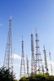 Transmission antenna towers. Various transmission antenna towers against blue sky Royalty Free Stock Photos