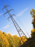A transmission line. Metal pole with a high voltage wires Royalty Free Stock Photo