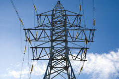 Transmission line. Support of a transmission line against the blue sky Stock Photo