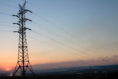 Transmission line. On a background of the coming sun Stock Image