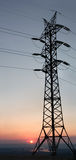 Transmission line. On a background of the coming sun Royalty Free Stock Image