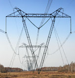 Transmission line. On a background of the blue sky Royalty Free Stock Image