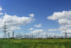 Transmission line and electrical substation on the background of blue sky Royalty Free Stock Photo