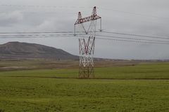 Transmission line. On green field Royalty Free Stock Images