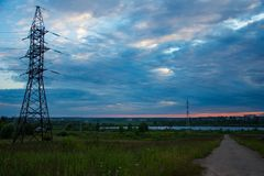 Transmission line and the lake stock photo