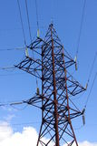 Transmission line tower. Yна a sky background royalty free stock photography