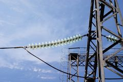 Transmission line tower. Power transmission line tower support on the sky background stock image