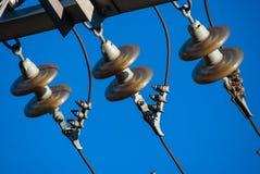 Transmission line tower. Detail of transmission line tower against blue sky stock images