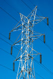 Transmission line tower. White transmission line tower against blue sky royalty free stock photos