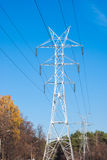 Transmission line tower. White transmission line tower against blue sky royalty free stock image