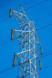 Transmission line tower. White transmission line tower against blue sky royalty free stock photography