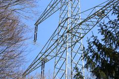 Transmission line. On background of blue sky Stock Photography
